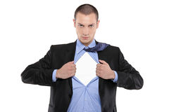 Superhero businessman opening blue shirt. Blank white t-shirt underneath provides excellent copy space for your image, text or logo royalty free stock images