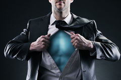 Superhero businessman. Pulls open shirt. Change and success concept Royalty Free Stock Photography