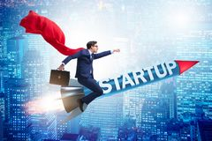 The superhero businessman in start-up concept flying rocket stock image