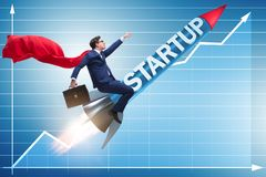 The superhero businessman in start-up concept flying rocket stock photo