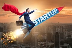 The superhero businessman in start-up concept flying rocket royalty free stock images