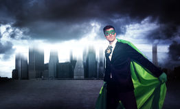 Superhero Businessman Strength Cityscape Cloudscape Concept Stock Images