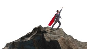 The superhero businessman on top of mountain stock image