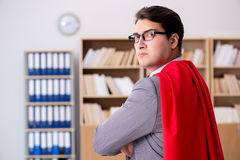 The superhero businessman working in the office Royalty Free Stock Image