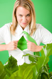 Superhero Businesswoman confident face green plant Stock Photo