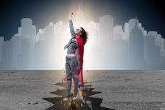 The superhero businesswoman escaping from difficult situation royalty free stock photography