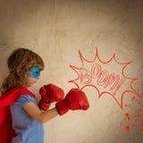Superhero. Child against grunge wall background stock images