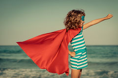Superhero child on the beach. Summer vacation concept Royalty Free Stock Images