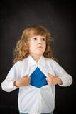 Superhero child in class Stock Images