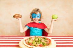 Superhero child eating superfood royalty free stock photos