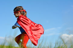 Superhero child - girl power Stock Photo