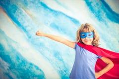 Superhero child at home Stock Photo