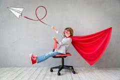 Superhero child playing indoor Royalty Free Stock Photo