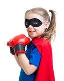 Superhero child wearing boxing gloves Stock Images