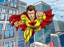 Superhero City Scene. Cartoon superhero in a pop art comic book style flying over a city Royalty Free Stock Photo