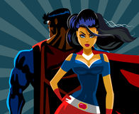 Superhero Couple: Male and female superheroes. Back to a back. P Royalty Free Stock Images