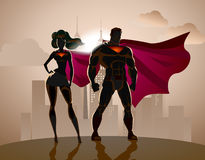 Superhero Couple: Male and female superheroes. Royalty Free Stock Image