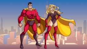 Free Superhero Couple Standing Tall In City Royalty Free Stock Image - 116204956