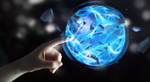 Superhero creating a power ball with his hand Stock Photography