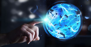 Superhero creating a power ball with his hand. Superhero creating an exploding blue power ball with his hand Royalty Free Stock Photos