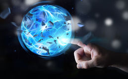 Superhero creating a power ball with his hand. Superhero creating an exploding blue power ball with his hand Royalty Free Stock Photo