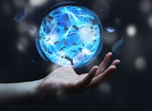 Superhero creating a power ball with his hand. Superhero creating an exploding blue power ball with his hand Royalty Free Stock Photography