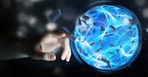 Superhero creating a power ball with his hand. Superhero creating an exploding blue power ball with his hand Royalty Free Stock Images