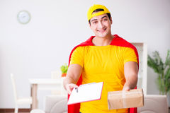 The superhero delivery guy with box Stock Photos