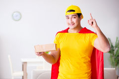 The superhero delivery guy with box Royalty Free Stock Photography