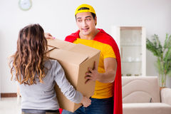 The superhero delivery guy with box Stock Image