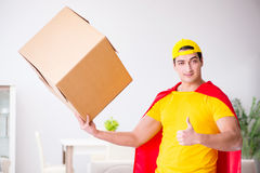 The superhero delivery guy with box Royalty Free Stock Images