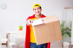 The superhero delivery guy with box Stock Photo