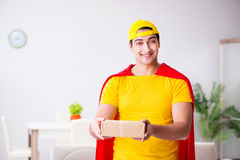 The superhero delivery guy with box Royalty Free Stock Photo