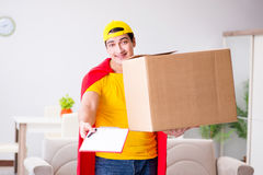 The superhero delivery guy with box Royalty Free Stock Image