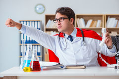 The superhero doctor working in the hospital lab Stock Image