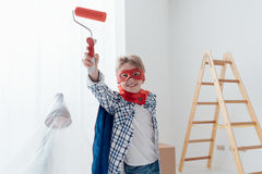 Superhero doing home renovation royalty free stock images