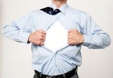 Superhero executive tearing his shirt Stock Images