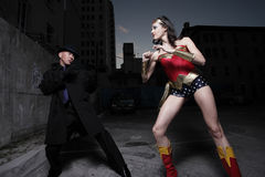 Superhero fighting the villain Stock Image