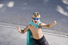 Superhero flexes his muscles Stock Images