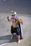 Superhero flexes his muscles Stock Photo