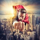 Superhero flies faster. Businessman superhero flies faster in the sky Royalty Free Stock Photography