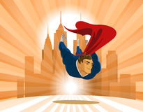 Superhero flies low over the earth. Stock Images