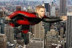 Superhero Fly Above Big City Royalty Free Stock Photos