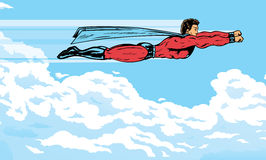 Superhero flying in the clouds Stock Image