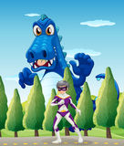 A superhero and a giant crocodile Stock Images