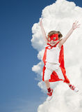 Superhero girl In clouds Stock Image