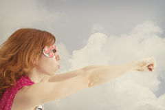 Superhero girl flying Royalty Free Stock Photography