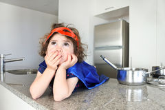Superhero girl thinks about what to eat or cook Stock Photos