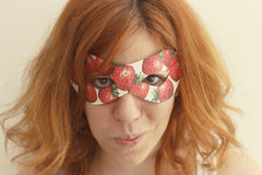 Superhero girl wearing mask with strawberries Stock Photos