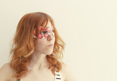 Superhero girl wearing mask with strawberries Stock Photography